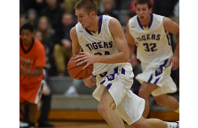 Junior Aaron Larson is the 39th Tiger to reach the 1,000 point milestone
