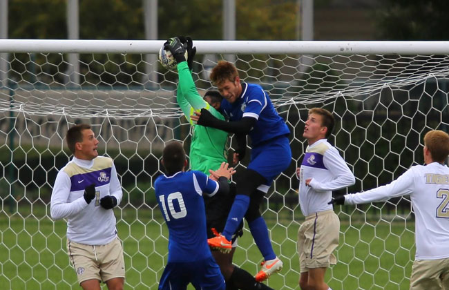 Olivet Nazarene's Chris Taborn (in green) registered his fourth shutout of the season on Wednesday.