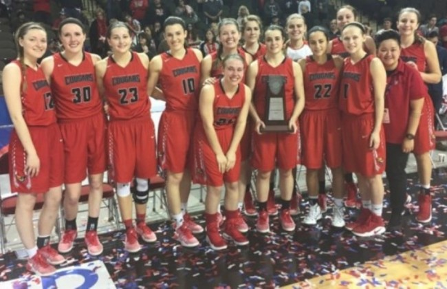 The No. 3 ranked SXU women's basketball team gather with their NAIA runner-up trophy after Tuesday's title game
