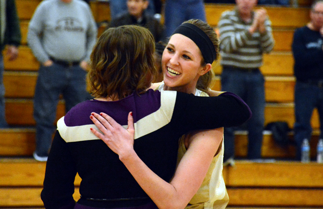 Katie Gonnering celebrates with Coach Quigley.